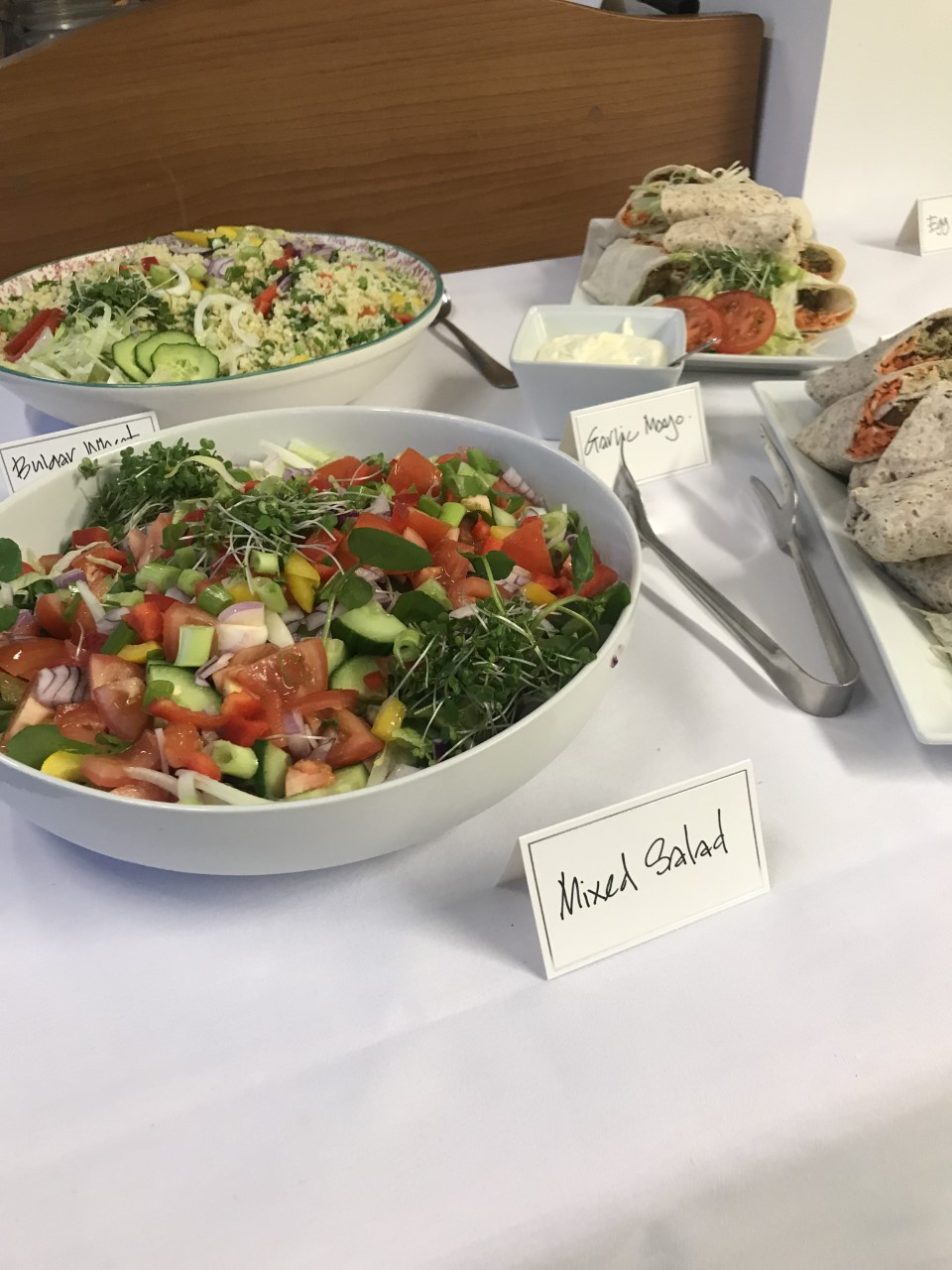http://Two%20delicious%20looking%20and%20colourful%20salads%20in%20bowls%20next%20to%20two%20plates%20of%20wraps,%20they%20all%20have%20neatly%20written%20labels.