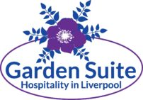 http://The%20Garden%20Suite%20logo%20which%20consists%20of%20a%20purple%20oval%20line%20with%20the%20words%20Garden%20Suite%20Hospitality%20in%20Liverpool%20in%20navy%20blue.%20There%20is%20a%20purple%20and%20white%20flower%20on%20the%20oval%20with%205%20navy%20leaf%20branches%20coming%20out%20of%20the%20petals.