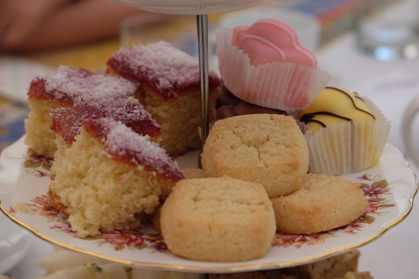 http://A%20close-up%20of%20a%20selection%20of%20afternoon%20tea%20cakes.%20We%20can%20see%20mini%20round%20shortbreads,%20small%20squares%20of%20jam%20and%20coconut%20sponge%20and%20some%20fondant%20fancies.