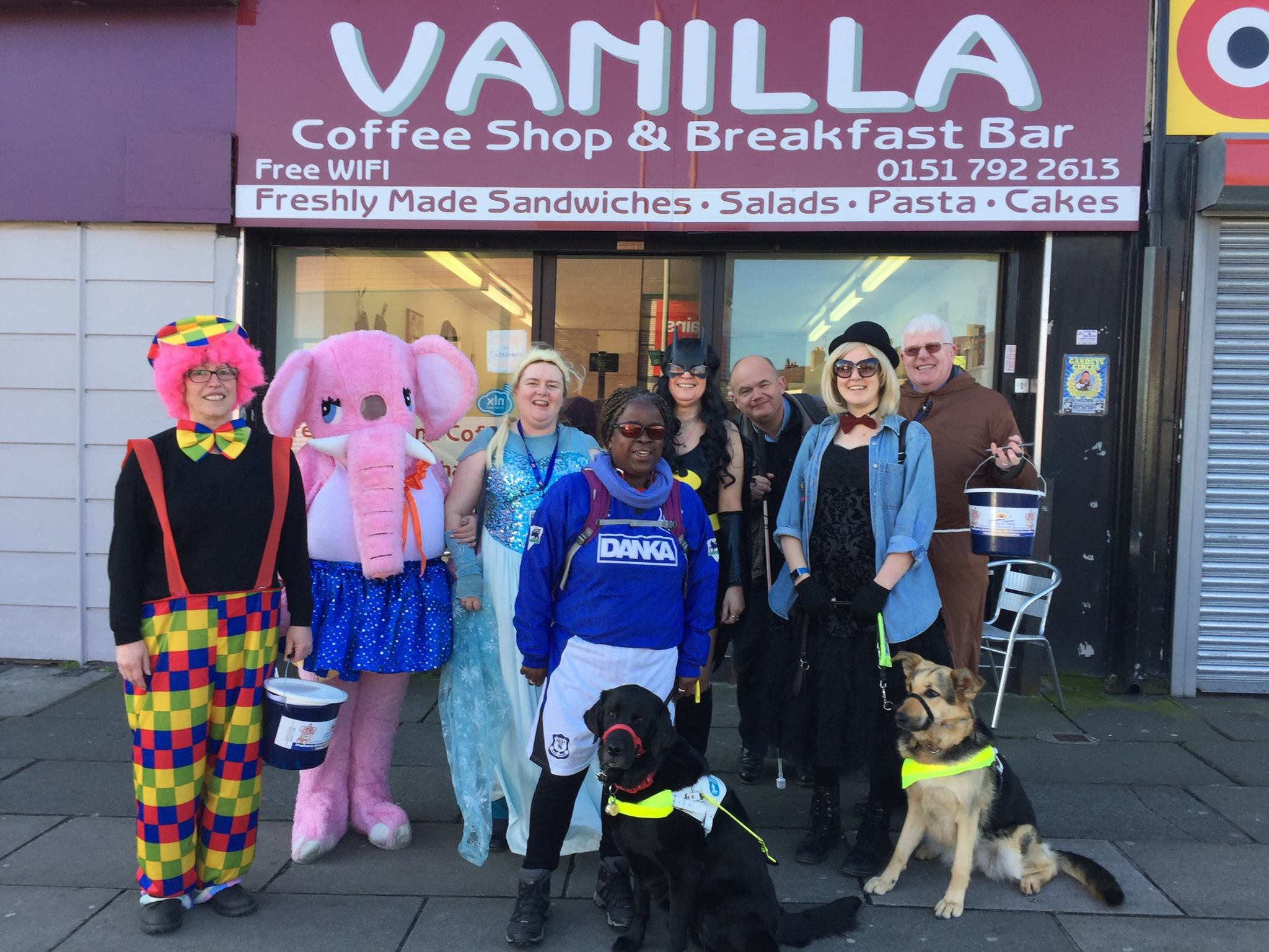 http://Eight%20service%20users,%20staff%20and%20volunteers%20wearing%20very%20silly%20costumes%20standing%20outside%20a%20cafe%20with%20a%20collection%20bucket.