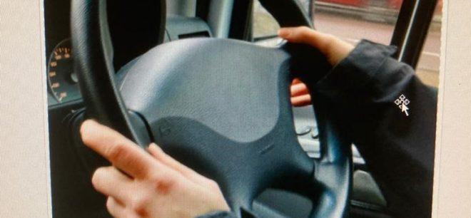 tewo hands on steering wheel