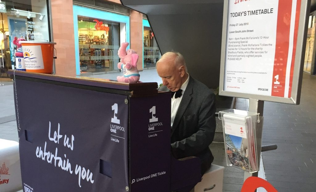 Frank playing the piano in Liverpool One